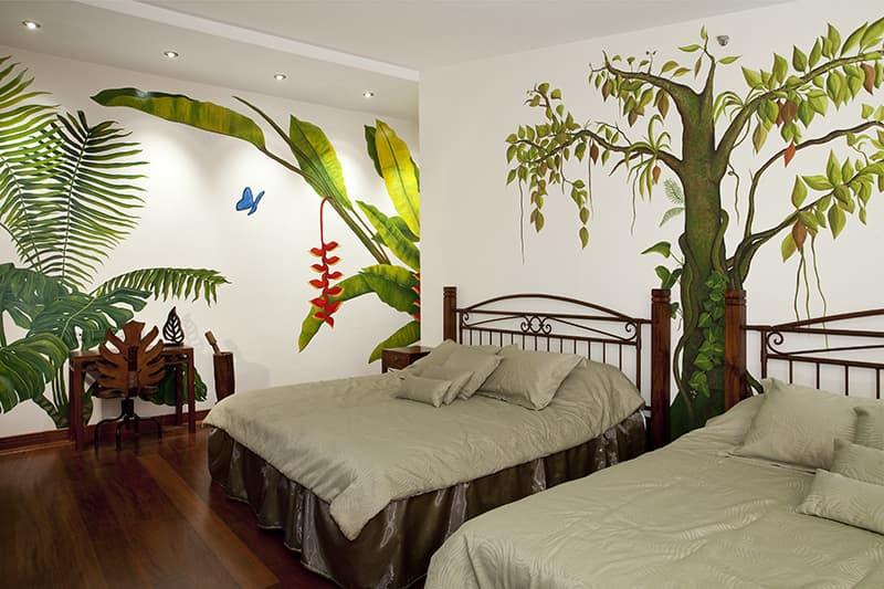 Hôtel Ikala à Quito, Equateur, suite double lits jumeaux sur le thème de l'Amazonie