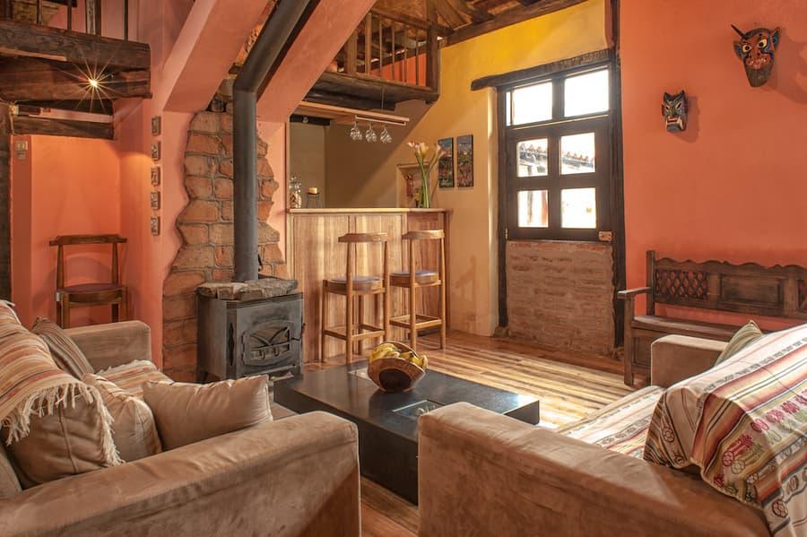 Hôtel Lodge Llullu Llama, Isinlivi près de la lagune Quilotoa, Equateur, salle de repos avec cheminée