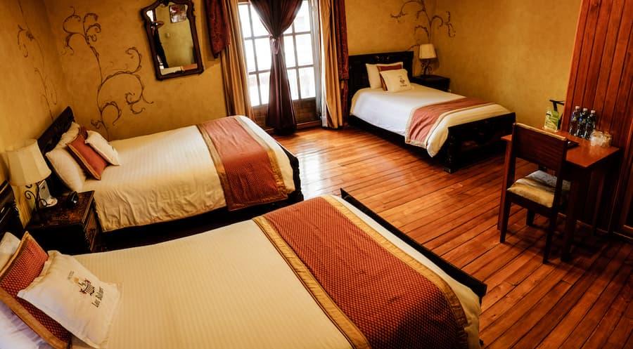 Hôtel Los Balcones, à Cuenca, Equateur, chambre triple