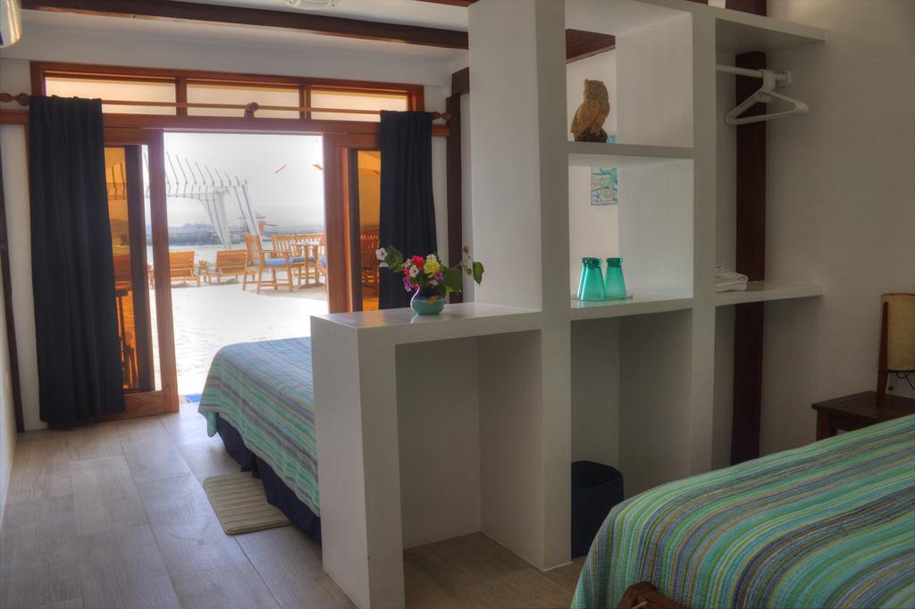 Chambre double vue sur jardin de l'hôtel Isabela Beach House